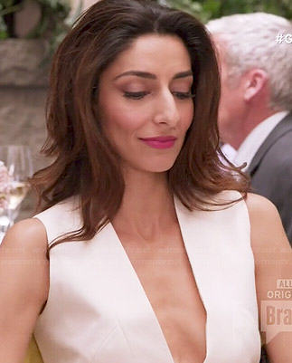 Delia's white v-neck dress on Girlfriends Guide to Divorce