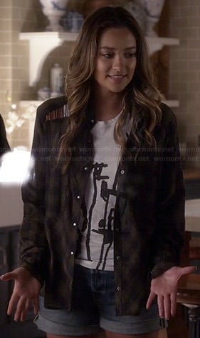 Emily's white drawing graphic top and plaid shirt with lace up shoulders on Pretty Little Liars