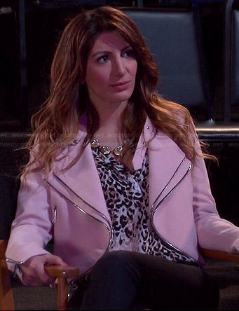 Jane's leopard print blouse and pink double-zip jacket on Mulaney