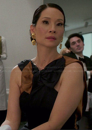Joan's navy and tan/gold bow gown on Elementary