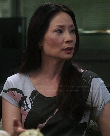 Joan's pink and black abstract graphic tee on Elementary