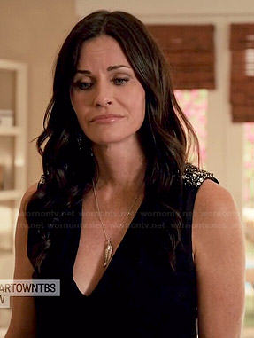 Jules's black v-neck top with embellished shoulders on Cougar Town