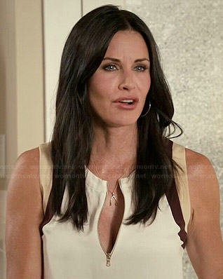 Jules's white zip front top on Cougar Town