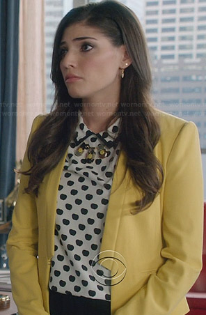 Lauren's black and white apple printed top and yellow blazer on The Crazy Ones
