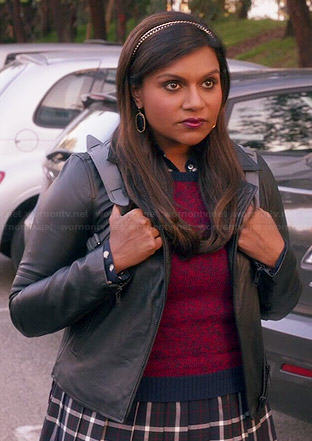 Mindy's plaid schoolgirl skirt, red sweater, leather jacket and leather backpack on The Mindy Project