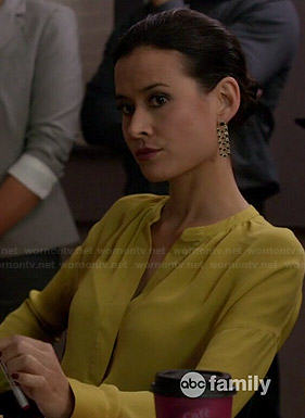 Raquel's yellow split-neck blouse on Chasing Life