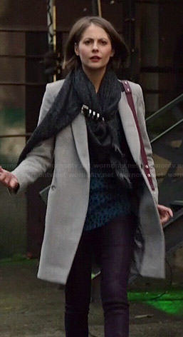 Thea's grey coat, blue leopard print top and buckled scarf on Arrow