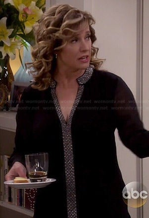 Vanessa's black blouse with printed trim on Last Man Standing