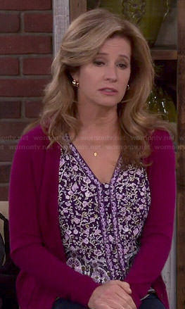 Vanessa's purple floral v-neck top on Last Man Standing