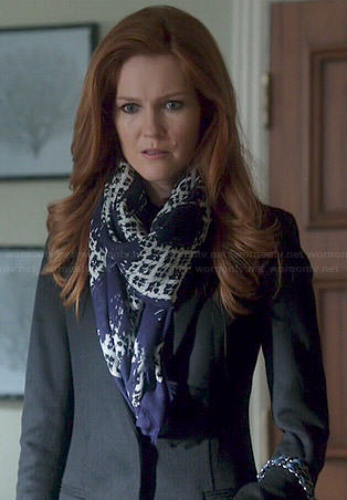 Abby's blue printed scarf and black coat on Scandal