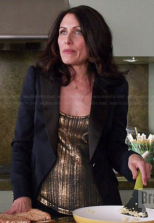 Abby's gold tank top and navy blazer on Girlfriends Guide to Divorce