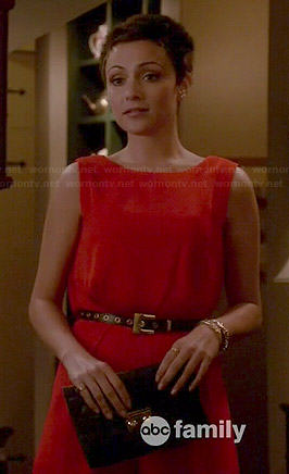 April's red open back romper on Chasing Life