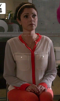 April's white blouse with orange trim on Chasing Life