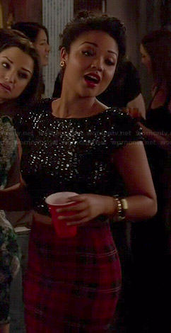 Beth's red plaid skirt and black sequin crop top on Chasing Life