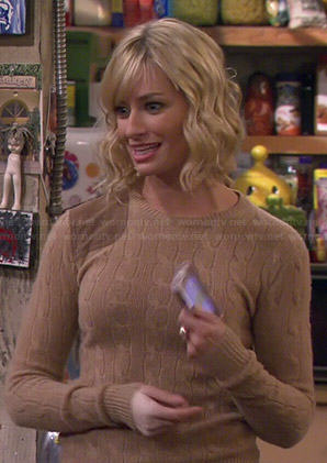 Caroline's beige cable knit sweater with suede shoulder patch on 2 Broke Girls
