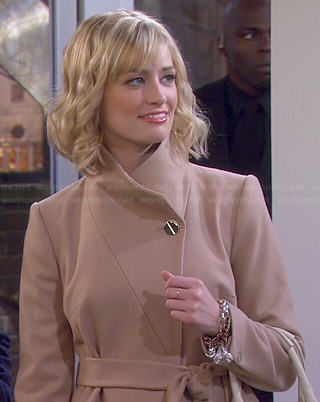 Caroline's biege coat on 2 Broke Girls