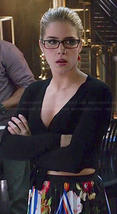 Felicity's black long sleeved wrap top and floral pleated skirt on Arrow