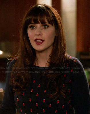 Jess's navy palace guards printed sweater on New Girl
