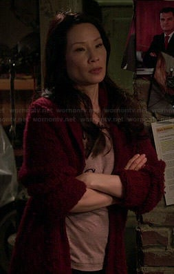 Joan's pink text graphic tee on Elementary