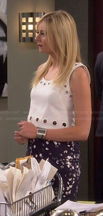 Maddie's white eyelet crop top and blue printed skirt on Cristela