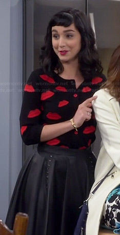 Mandy's lips cardigan and leather skirt on Last Man Standing