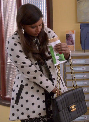 Mindy's black and white lace dress and polka dot coat on The Mindy Project