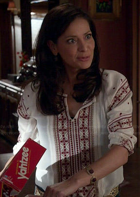 Regina's white top with red embroidery on Switched at Birth