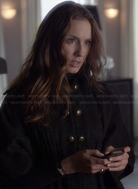 Spencer's black cape with gold buttons on Pretty Little Liars