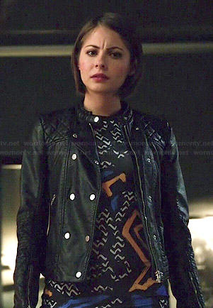 Thea's graffiti printed dress and leather jacket on Arrow