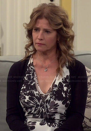 Vanessa's black and white floral print v-neck top on Last Man Standing