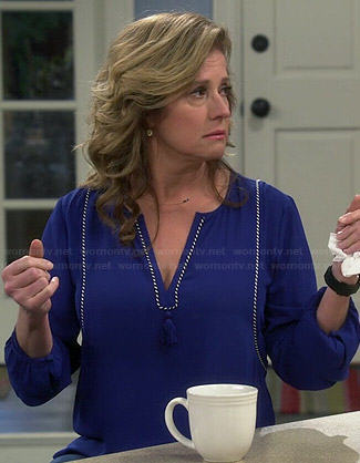 Vanessa's blue top with tassel on Last Man Standing