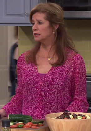 Vanessa's pink printed v-neck blouse on Last Man Standing