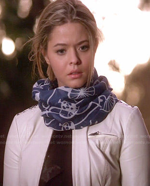 Ali's white leather jacket with lace up sleeves and blue bicycle print scarf on Pretty Little Liars