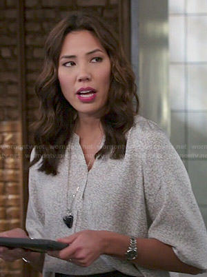 Angela's grey printed blouse on Bones