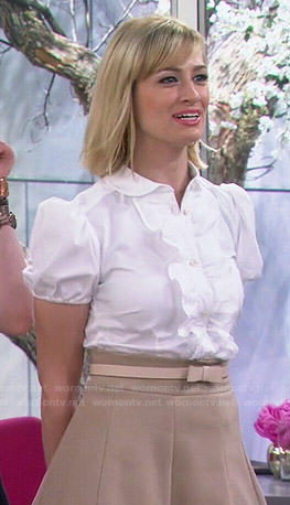 Caroline's white ruffle front shirt on 2 Broke Girls
