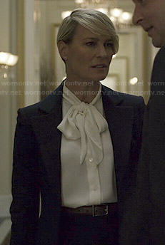 Claire's white neck bow blouse and navy blazer on House of Cards