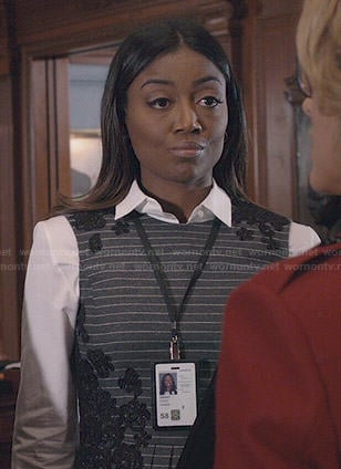 Daisy's striped peplum top with floral applique on Madam Secretary