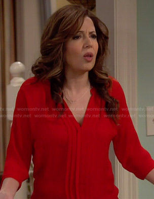 Daniela's red pleated front blouse on Cristela
