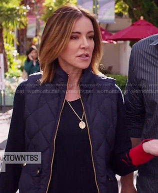 Ellie's navy sweater with red cuffs and quilted vest on Cougar Town