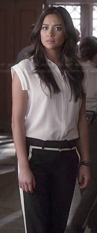 Emily's white sleeveless shirt and black and white trousers on Pretty Little Liars