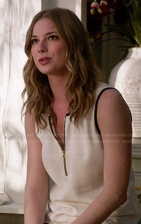 Emily's white zip front top with black trim on Revenge