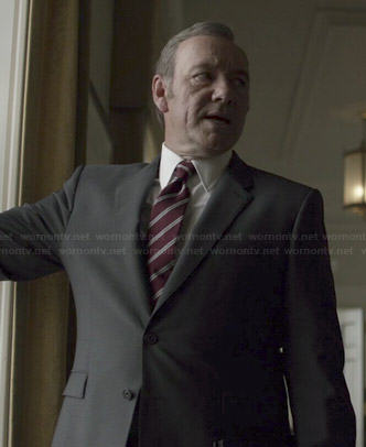 Francis's black suit with burgundy diagonal striped tie on House of Cards