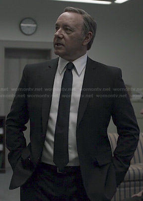 Frank's black suit and solid black tie on House of Cards