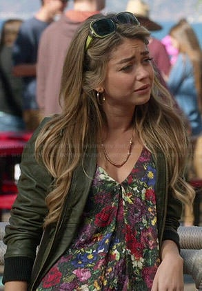 Haley's floral top and olive green leather bomber jacket on Modern Family
