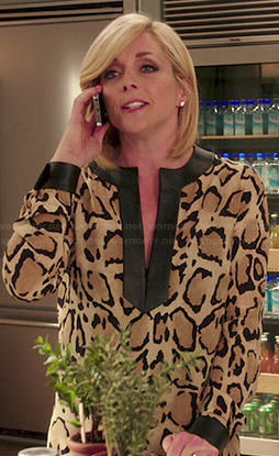 Jacqueline's leopard print blouse with leather trim on Unbreakable Kimmy Schmidt
