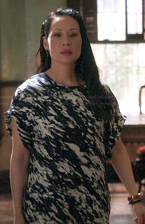 Joan's black and white paint printed t-shirt dress on Elementary