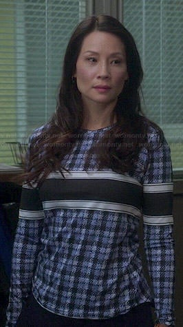 Joan's blue checked and stripe long sleeve top on Elementary