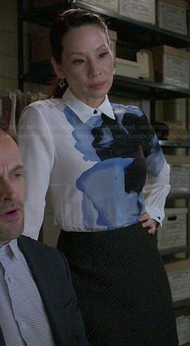 Joan's white shirt dress with blue flower on Elementary