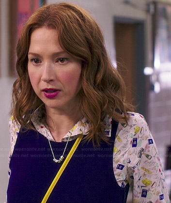 Kimmy's French printed shirt and navy dress on Unbreakable Kimmy Schmidt