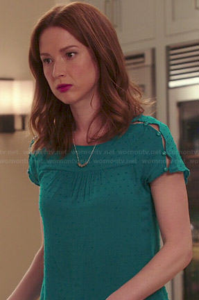 Kimmy's teal green button shoulder top on Unbreakable Kimmy Schmidt